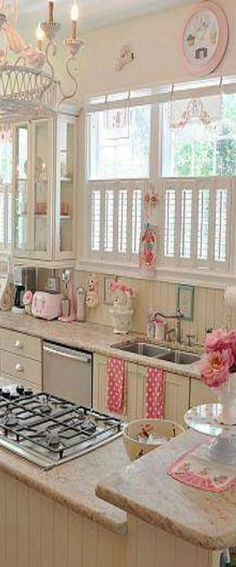 Love the glass cabinet.  Other than a few things that I would need to get rid of...I could enjoy being in this kitchen.