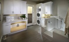 The downstairs pet suite features a stacked washer and dryer, linen cabinets and a dedicated wash zone for your pups. - Residence 2 at Kingston at Del Sur in San Diego, CA
