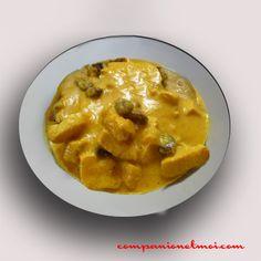 Poulet au curry noix de coco et raisins secs
