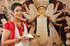 Durga Puja is the biggest and most important occasion of the year in Kolkata. The magnificence of the festival is revealed in these Durga Puja pictures.