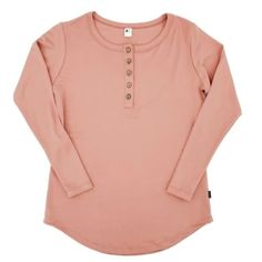 Women's Long Sleeve Henley| Light Pink The perfect soft neutral pinkto add to your wardrobe! Introducing our new Women's Long Sleeve Henley Shirt! This new style features a scoop hem in an extra long length that makes it a perfect pairing for leggings! Your new, go-to cozy outfit! Details: Fabric - 66% Rayon from Ba Women's Henley, Henley Shirts, Long Sleeve Henley, Salmon, Neutral, Blouse, Cozy, Leggings, Fabric