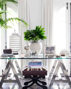 A California-style tableau in the light-filled living room: A chrome-and-glass sawhorse table by Ralph Lauren Home holds collected objects, including an antique white vase from Oriental Treasures; the bench is by Jan Showers.