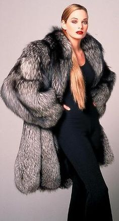 Picture yourself in  this must have Medium length Gorgeous- Real  Silver Fox fur coat. Enjoy the lush softness of the fur as it caresses your lovely neck, the admiration of the public when they think you're a model or movie star. It's no wonder this beautiful fur coat is getting the most Pins on Pinterest.