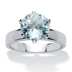 A stunning round blue topaz sits regally atop this ring distinguished with a light and airy elegance. Sure to be noticed-TT5JbIdw