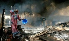 Photograph by Akintunde Akinleye   The aftermath of a Nigerian pipeline explosion
