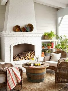 Enclosed Area The combination of warm weather and a fireplace (painted China White by Benjamin Moore) makes the outdoor living area of this California home a year-round hangout. Read more: Fireplace Designs - Fireplace Photos - Country Living Outdoor Living Areas, Outdoor Rooms, Living Spaces, Outdoor Seating, Living Rooms, Indoor Outdoor, Porch Fireplace, Fireplace Design, Fireplace Ideas