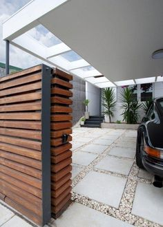 Create a hidden driveway with a partial wall.