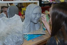 My eighth grade artists created self-portraits in clay.