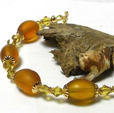http://www.etsy.com/listing/70811839/large-oval-frosted-gold-beads-with-8mm