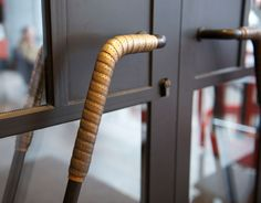 Cast doorhandles that look like bike bar tape. Ace Hotel Shoreditch