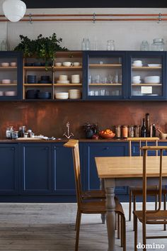 blue kitchen cabinets and copper backsplash