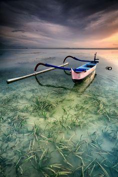 """Half of Boat by Ina Herliana Koswara on 500px A traditional """"jukung"""" boat at Sanur Beach, Bali."""