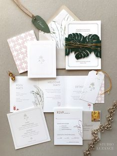 Palm Springs wedding invitation with a tropical vibe and a laser cut belly band via Studio Luzance