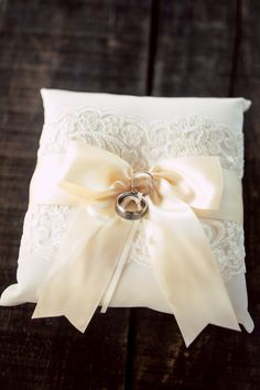 What a #darling #littlepillow for the #weddingrings! ::Jessica + Clint's wonderfully bright summer wedding in Murphys, California:: #silkbow #weddingdaydetails #ceremonydetails #cuteidea #sweet #weddingbands