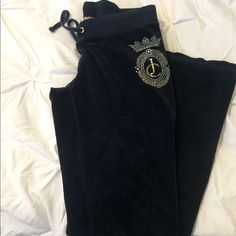 Juicy couture velvet navy blue pants.  Beautiful juicy sweat pants material is a soft velvet type. Super comfy and great for the cold weather or to just wear around the house! Boot cut so not to big from the bottom just perfect.  Juicy Couture Pants Boot Cut & Flare