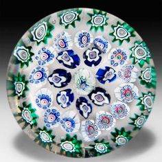 Antique New England Glass Company concentric millefiori with running rabbit canes paperweight. by American