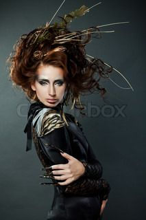 High fashion model in black dress, with long nails and creative hairstyling on grey background | Stock Photo | Colourbox on Colourbox