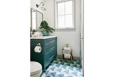 Small bathroom huge impact with tile and cabinet.  LOVE