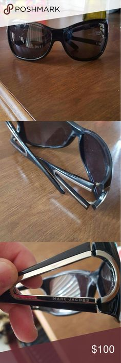 100% authentic Marc Jacobs sunglasses FOR SALE OR TRADE! 100% authentic Marc Jacobs sunglasses in excellent condition periods Black sunglasses with silver on both sides. If you would like to see more pictures or have any questions please leave me a comment below Marc Jacobs Accessories Sunglasses