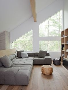 White walls, large windows and exposed wood beams in the vaulted ceiling keep this loft bright and airy.