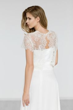Wedding gown cover up created of delicate ivory full beaded lace. This top is finished with scalloped edge on sleeves ,hem and back . Lace topper