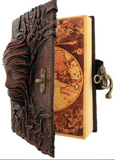 Sculpted leather journals - usable art from www.pandorasbox.net.au