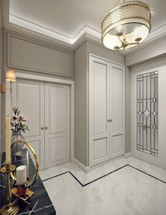 Modern Classic Villa Interior Design 16- A luxurious entrance hallway of a modern classic villa interior by Comelite Architecture Structure and Interior Design, Carrara marble floor tiles with thin black border, gray walls and classic white paneled doors, elegant brass chandelier.