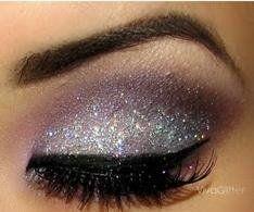Pretty sparkling eye make up.