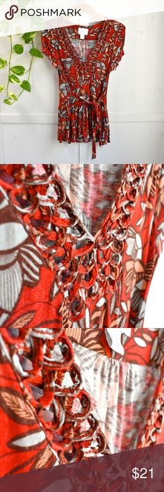🎉HP🎉 Anthropologie Red Soutache Peplum Top Host Pick for Best in Tops party on 6/7/17! This vivid red floral top has so many details--a looped soutache design along the v-neckline, ruched cap sleeves gathered with red grosgrain ribbon, a fluttery peplum hemline and wrap ties along the waist to show off your curves. In gently used but great condition with no damage or stains. Deletta for Anthropologie size small. Anthropologie Tops Blouses