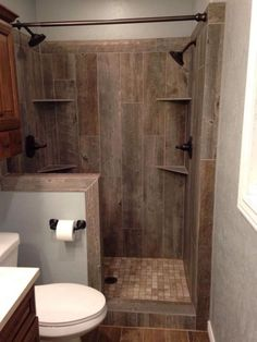 A must have in my farmhouse! Need this wood tile shower :) 28 Rustic Bathroom Ideas Making Impact to Atmosphere Small Rustic Bathrooms, Beautiful Small Bathrooms, Amazing Bathrooms, Tiny Bathrooms, Primitive Bathrooms, Narrow Bathroom, Small Cabin Bathroom, Brown Bathroom, White Bathrooms
