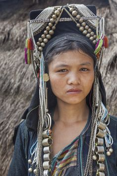 A young Akha tribeswoman in traditional clothing