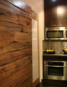 love the tin tile backsplash in concert with the wood wall!