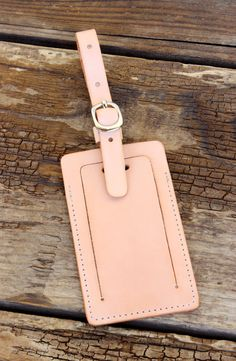 Handcrafted natural veg-tan leather luggage tag by Tagsmith $40