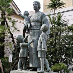 A statue of a single mother at the Yasukuni Shrine in Tokyo, Japan.