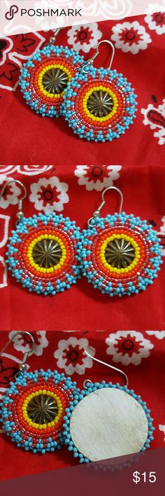 Beaded Indian Made Earrings Multicolored round beaded earrings with brass Center and leather backing. You can see from pic above these are handmade. Beads are stitched to leather backing. Purchased in New Mexico Jewelry Earrings