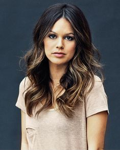 long, layered, darker hair with sun-kissed ends...this will be a hit in the Spring...easy to lighten up throughout the summer months.