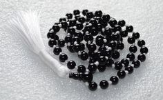 BLACK ONYX JAPA JAAP MALA TOP QUALITY AAA GRADE (108+1) HINDU TIBETAN BUDDHIST PRAYER KARMA BEADS SUBHA ROSARY MALA FOR NIRVANA, BHAKTI, FOR REMOVING INNER DOSHAS, FOR CHANTING AUM OM, FOR AWAKENING CHAKRAS, KUNDALINI THROUGH YOGA MEDITATION. HAND KNOTTED. EACH KNOT BETWEEN BEADS DONE BY RECITING MANTRAS WITH POSITIVE VIBES & ENERGY TO INFUSE MAXIMUM POWER.  FREE MALA POUCH INCLUDED. THE MALA HAS 6 MM BLACK ONYX GURU BEAD.  PLEASE ALSO NOTE THAT SLIGHT VARIATIONS IN COLOR, SHAPE, SIZE, TE...