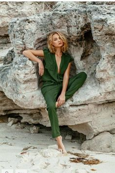 Taking inspiration from military detailing, the Santa is the jumpsuit of the summer. With cargo chest pockets and gold buttoned shoulder lapels, the Santa is detailed in all the right places and the perfect piece for apres plage. Draw attention to a slim waistline with an adjustable waist tie and make heads turn with a daring neckline.   Santa Jumpsuit by Melissa Odabash. Clothing - Jumpsuits & Rompers - Jumpsuits Miami, Florida