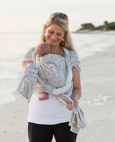 Newborn Kangaroo Carry Woven Wrap Tutorial step 9: tie knot under baby