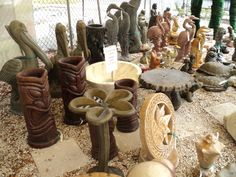 Assorted Concrete Planters, Bird Baths and Statues. Egrets, Flamingos, Bird Baths, Sun and Moon, Table, Conch Shell.