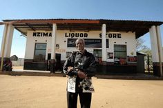 Photojournalist Sam Nzima stands outside Nzima Liquor Store in his home village of Lilydale in Mpumalanga, 24 June 2014. Nzima opened the store in 1977 after fleeing Soweto following threats against his life.  Picture: Refilwe Modise