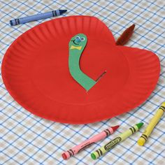 Peekaboo Apple Paper Plate. Instead of paper clip, use a thread to fasten the worm to paper plate while it's still movable.
