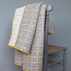 Named for the beloved sourdough bread, this rugged reversible blanket has a grid pattern of fine lines and a contrasting tumeric stitched edging. Eleanor Pritchard has re-interpreted the weaving vernacular with a modern twist on woven woolen blankets. Serene Bedroom, Modern Bedroom, Blanket Stitch, Wool Blanket, Modern Spaces, Modern Retro, Geometric Designs, Fabric Design, Quilt Design