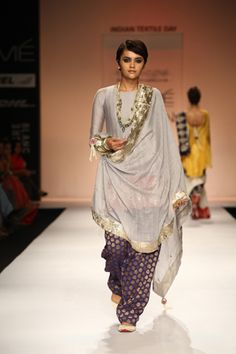 Dusk grey silk mul cropped anarkali with red silk embroidered border worn with blue banarsi cotton shalwar and silk mul dupatta. SHOP THE LOOK: http://www.payalsinghal.com/off-the-runway/tabassum-anarkali