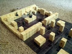 """Elevated terrain for use in Heroclix or other similar gaming maps. Cut from a few 2""""x2""""x8' poles into 3"""", and 1.5"""" heights, with 0.75"""" heights for use as stairs. Rubberbands allow for endless configuration changes. Will probably sand and stain blocks at some point. - By Matt Hill"""