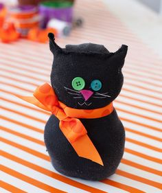 Kids can't get bored with this quick and easy 15-minute craft. All you need is a black sock, cotton batting, buttons, pink felt, ribbons, and black thread. You might want to cut the sock first, then sew it up after the kids stuff it with batting. Glue can also be used if you want to make it more hands-on for the kids.