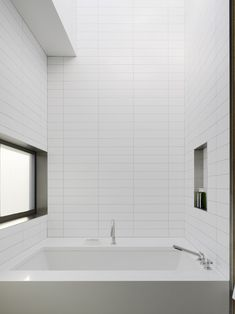 Palo Alto, CA, residence by CSS Architecture | White tile, white grout. maybe too austere? SKYLIGHT ABOVE!