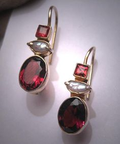 A Wonderful Pair of Vintage Victorian - Georgian Revival Earrings with Pearls and Garnet Gems in Etruscan Revival Gold Upon Sterling Silver Settings. These estate earrings are done in the Georgian - Victorian Revival Style and are adorned with faceted deep rich red garnets and