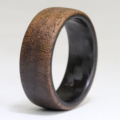 The Lumberjack - Carbon Fiber Ring and Walnut Wood Wedding Ring. Great for Men's Wedding Rings or Engagement Rings. Great groomsmen gift The Lumberjack - Twill Carbon Fiber and Walnut Wood Wedding Ring Wood Rings, Wedding In The Woods, Schmuck Design, Stainless Steel Rings, Wedding Men, Gift Wedding, Men Wedding Rings, Mens Wooden Wedding Bands, Luxury Wedding