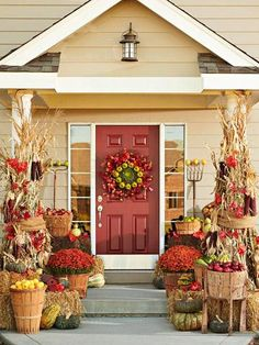 Fresh-picked apples fill vintage harvest baskets (stuff bottoms with newspaper). Dried cornstalks, attached to porch posts with wire hidden under burlap, add sizable impact. Indian corn, various gourds, and an old rake and pitchfork round out the country theme. Unite this riotous mix with pots of red mums and red fall leaves (we used fakes!).
